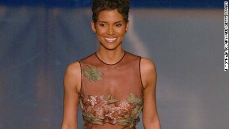 HOLLYWOOD, : Best Actress nominee Halle Berry prepares to present the Oscar for achievement in Sound during the 74th Academy Awards at the Kodak Theatre in Hollywood, CA, 24 March 2002. AFP PHOTO/TIMOTHY A. CLARY (Photo credit should read TIMOTHY A. CLARY/AFP/Getty Images)