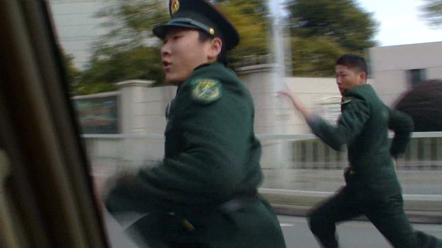 2013: China security officers chase CNN crew