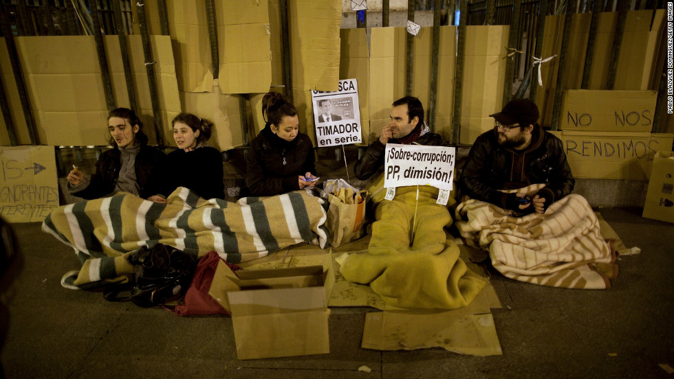 Demonstrators camp at a protest in Puerta del Sol Square after a demonstration against alleged corruption scandals implicating the PP (Popular Party) on February 3 in Madrid, Spain.