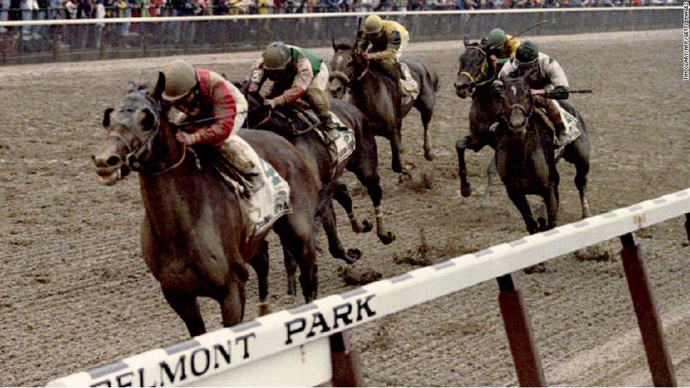 Jockey Julie Krone rides Colonial Affair across the finish line to win the Belmont Stakes on June 5, 1993. She was the first woman to win a Triple Crown race.