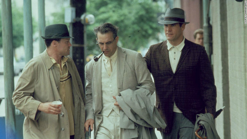 "Kevin Costner, center, played district attorney Jim Garrison with Michael Rooker, and Jay O. Sanders in ""JFK,"" directed by Oliver Stone. <a href=""http://www.rogerebert.com/reviews/great-movie-jfk-1991"" target=""_blank"">""I have no opinion on the factual accuracy of his 1991 film 'JFK.' I don't think that's the point. This is not a film about the facts of the assassination, but about the feelings. ... 'JFK' is a masterpiece."" ... it ""is a brilliant reflection of our unease and paranoia, our restless dissatisfaction.""</a>"
