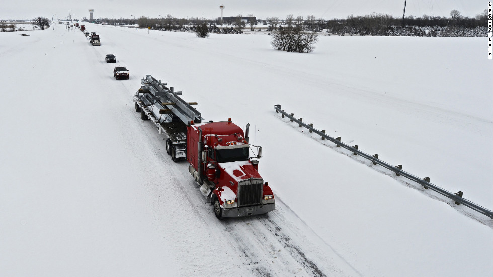 Vehicles drive in single file down Highway 135 outside Wichita on Thursday.