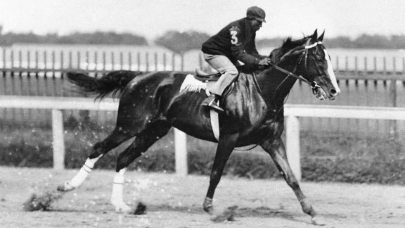 """Winkfield rides to victory in the 1902 Derby. """"He was the LeBron James of his time. Not only was he fabulously talented, he transcended the sports pages to the celebrity pages,"""" author Joe Drape said."""