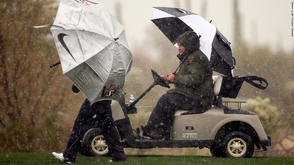 Mark Russell, right, vice president of rules and competition for the PGA Tour, talks with Thorbjorn Olesen of Denmark as snow and rain suspend play during the first round of the World Golf Championships in Marana, Arizona, on Wednesday, February 20.