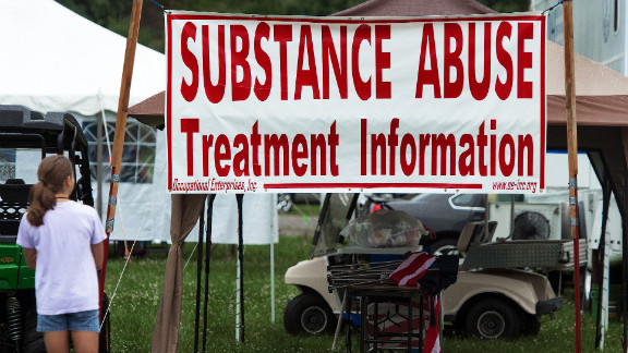 A teenage girl takes a look at a substance abuse booth that didn't seem to be staffed all day at a county fair in Wise, Virginia.
