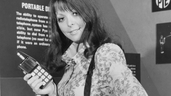"""In this image from 1972, a model demonstrates a """"portable radio-telephone"""" by Pye Telecommunications at a London exhibition called """"Communications Today, Tomorrow and the Future."""""""