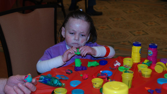 Rafi Kopelan keeps busy with her Play-Doh, July 2012.