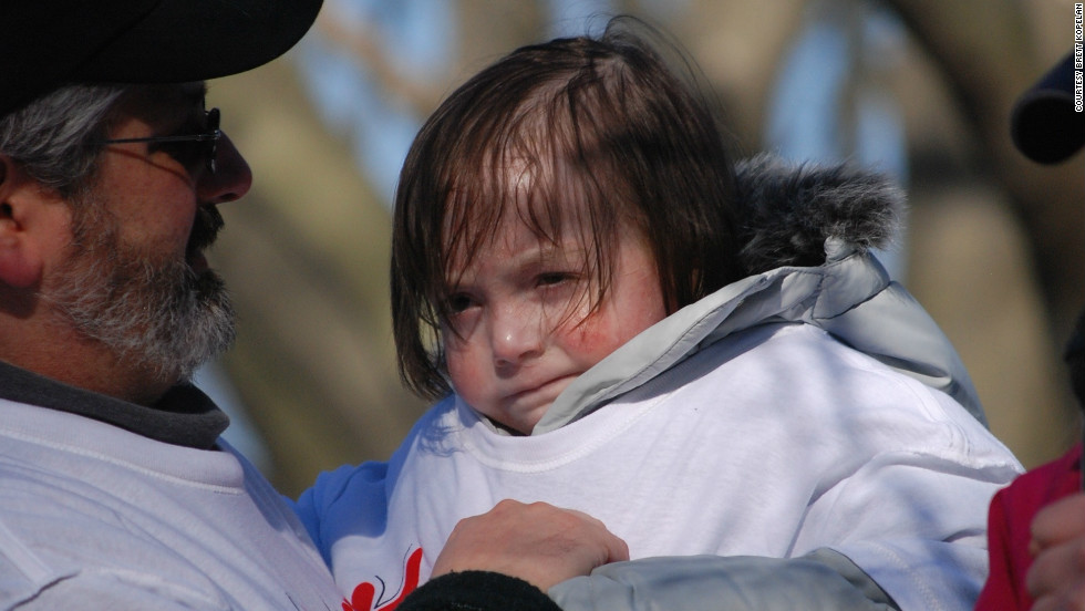Rafi braves the cold to watch the runners cross the finish line at the first Rafi's Run in March 2012.