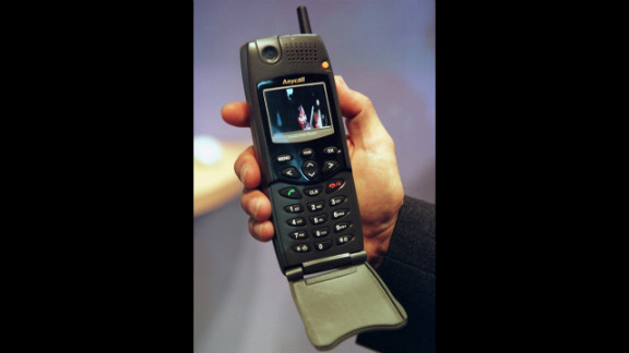 It's Y2K ready! A Samsung Electronics employee shows off this spiffy ''Millennium Multimedia Phone IMT-2000'' at a trade show in 1999 in Geneva, Switzerland.