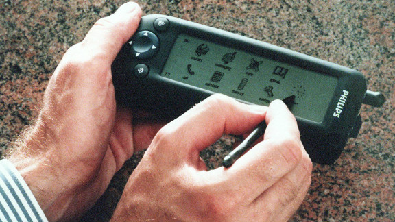 Philips demonstrates its new digital phone, The Synergy, in 1997 at a press conference in Dubai. The then-advanced device offered wireless access to e-mail, Internet and faxes.