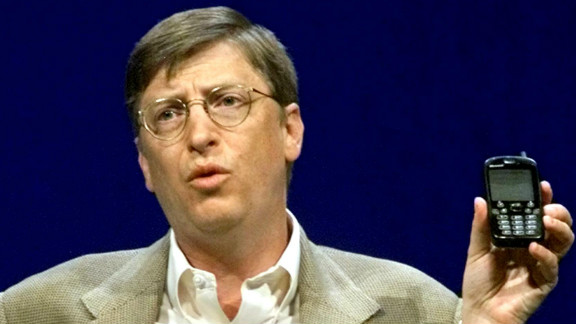 """Even Microsoft chairman Bill Gates was not immune from holding ugly phones. Here he makes a point with a """"new generation"""" cellphone during his annual """"state of the industry"""" speech at the COMDEX convention in Las Vegas in November 2000."""