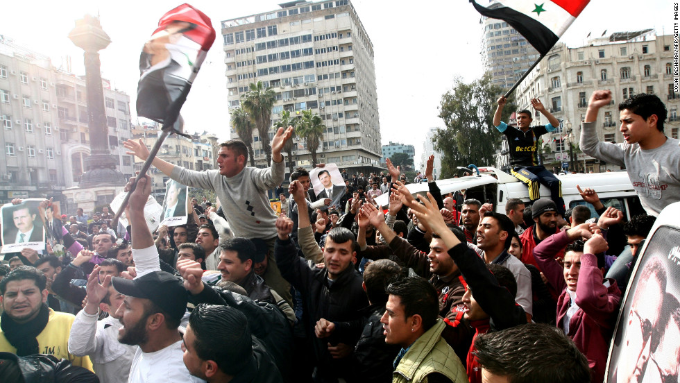 Syrian protesters chant slogans in support of al-Assad during a rally in Damascus on March 25.