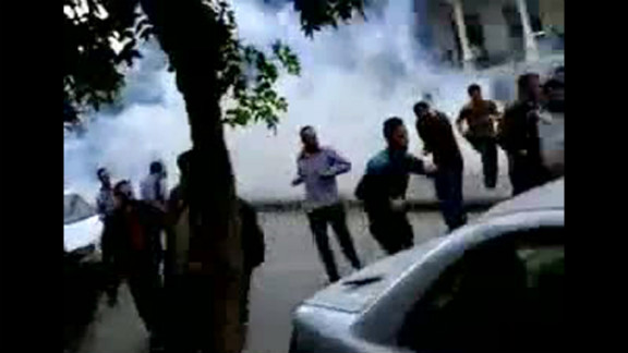 """A screen grab from YouTube shows Syrian anti-government protesters run for cover from tear gas fired by security forces in Damascus on April 29, 2011, during the """"Day of Rage"""" demonstrations called by activists to put pressure on al-Assad."""