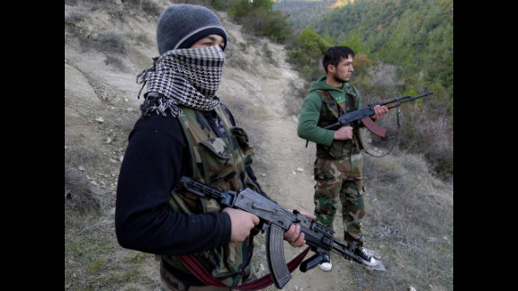 Members of the Free Syrian Army stand in an valley near the village of Ain al-Baida, close to the Turkish border, on December 15, 2011.