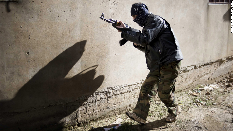 A rebel takes position in Al-Qsair on January 27, 2012.