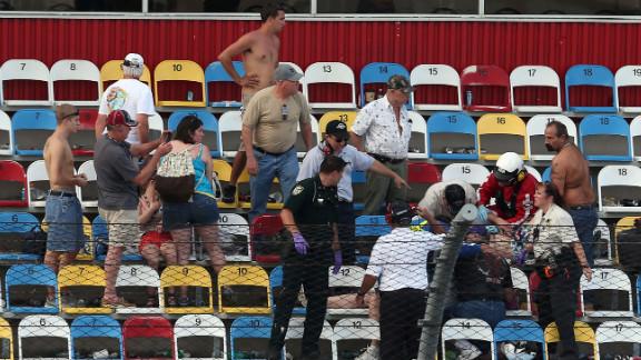 Medical personnel assist fans.