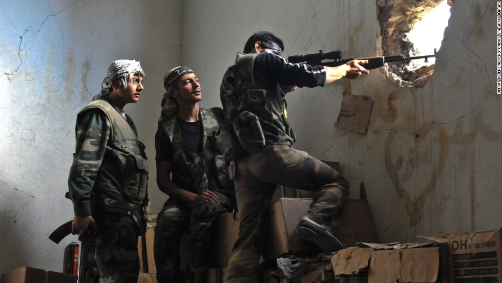 Rebels hold their position in the midst of a battle on November 3, 2012 in Aleppo.
