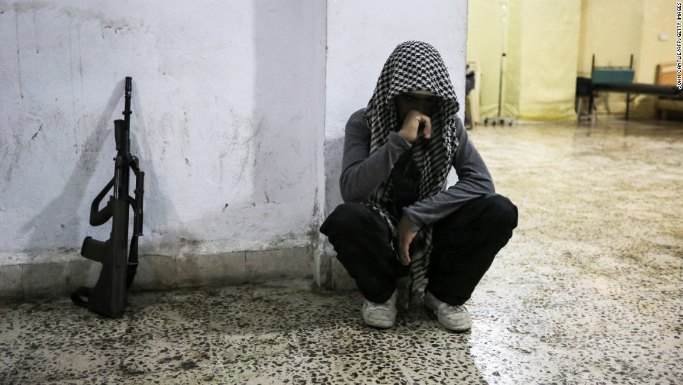 A Syrian rebel mourns the death of a comrade in Maraat al-Numan on November 20.