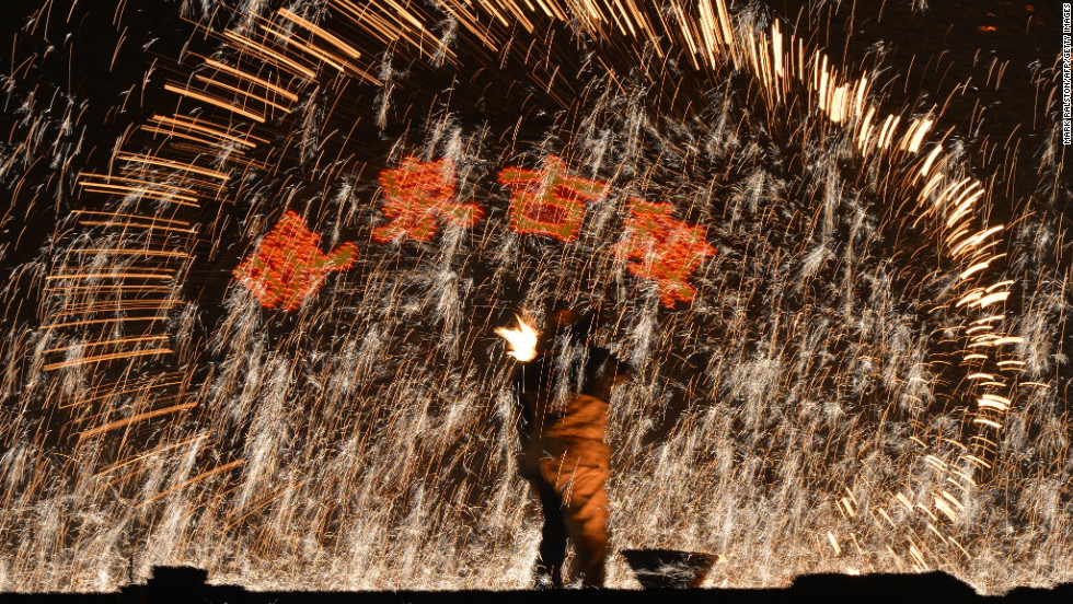 A Chinese blacksmith throws molten metal against a cold stone wall to create sparks in the Nuanquan, Hebei province on February 24. For more than 300 years, the village has kept the tradition as a less expensive alternative to buying fireworks during the Lantern Festival.