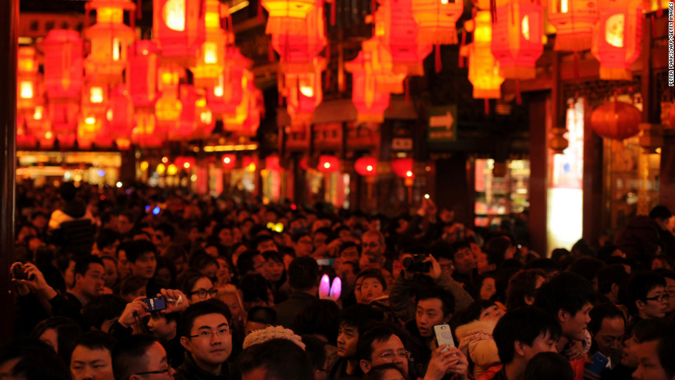 Visitors look at lanterns in Yuyuan Gardens on February 24.