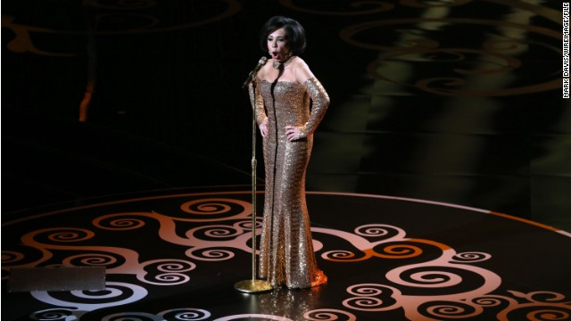 The character Celestina Warbeck is said to resemble singer Shirley Bassey, here performing at the 2013 Oscars.