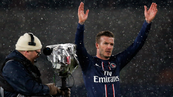 David Beckham acknowledges the crowd after making a winning debut for PSG against Marseille.