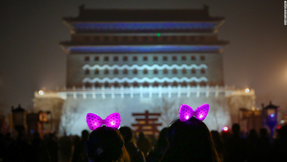 Two girls don glowing bows as they visit the Qianmen shopping district in Beijing for the Lantern Festival on February 24.