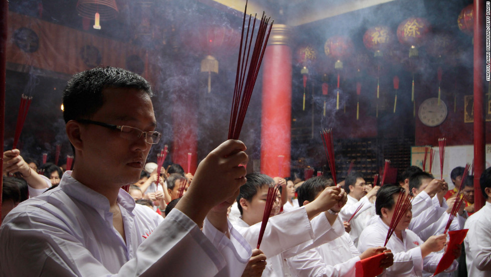 Ethnic Chinese Indonesians say prayers at a temple on February 24 in Jakarta.