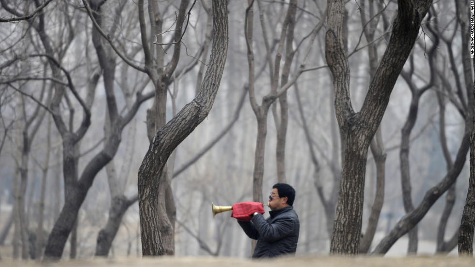 A musician plays the suona, a traditional wind instrument, at a Beijing park during the Lantern Festival on February 24.