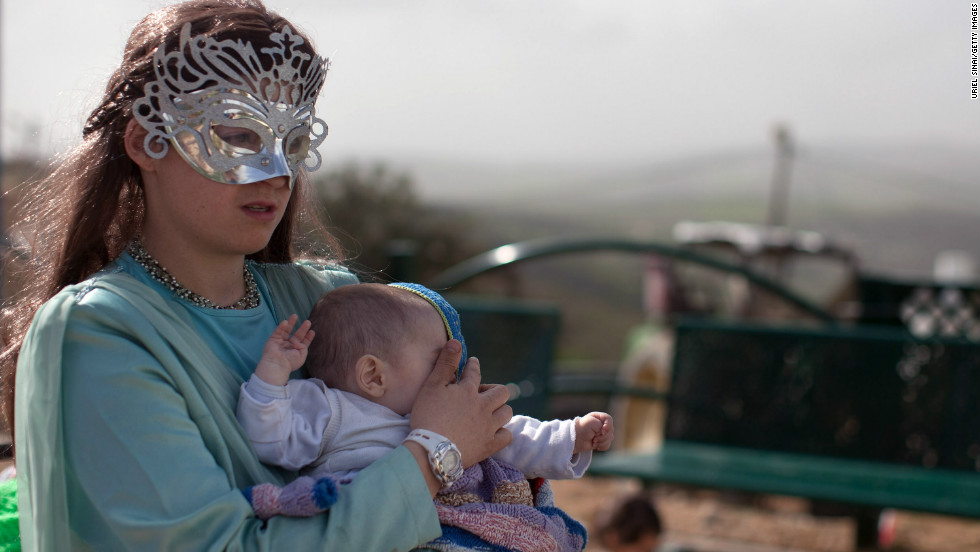 Jewish settlers celebrate the Jewish festival of Purim at the settlement outpost of Havat Gilad, West Bank.