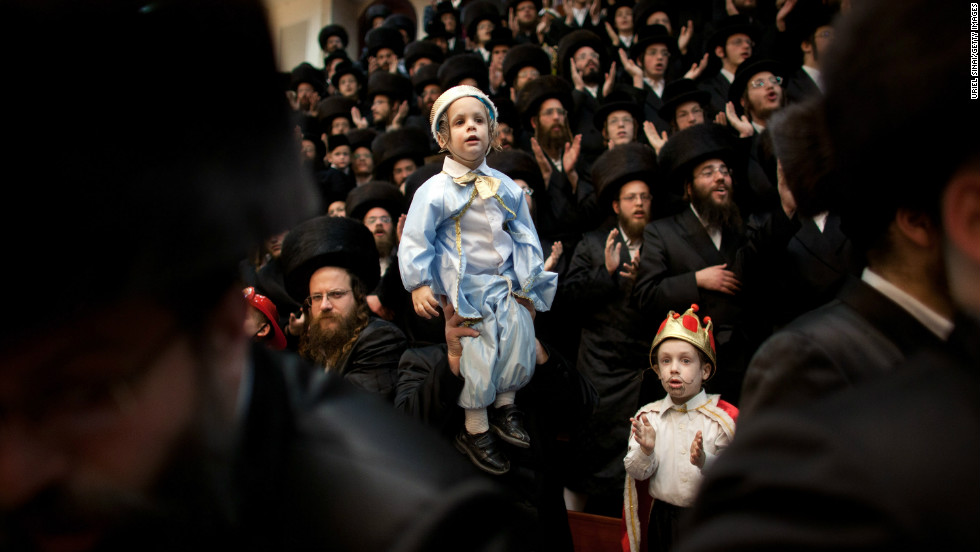 A synagogue in Bnei Brak, Israel, is packed with Ultra-Orthodox Jews celebrating Purim. The carnival-like Purim holiday is celebrated with parades and costume parties.