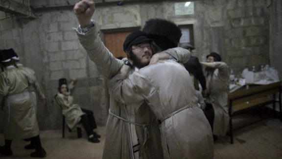 Ultra-Orthodox Jews belonging to the Lelov Hasidic sect, celebrate the Jewish festival of Purim late on February 24 2013 in Beit Shemesh, a religious town near Jerusalem.
