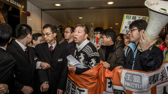 Activists demonstrate against the bid to punish striking drivers at the Singaporean consulate in Hong Kong on December 5, 2012.