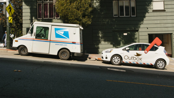 """Outbox, a new startup, seeks to cut down on paper clutter by digitizing subscribers' physical mail. The service is launching in San Francisco, where an Outbox """"unpostman"""" drives around in a Toyota Prius emblazoned with the Outbox logo and a giant plastic mailbox flag."""