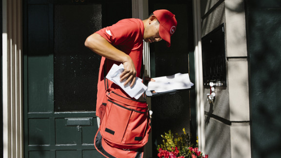 """Outbox """"unpostman"""" Francis uses one of his many keys to pick up mail from a customer. The mail will be taken to a warehouse to be digitized, then sent electronically to the client."""