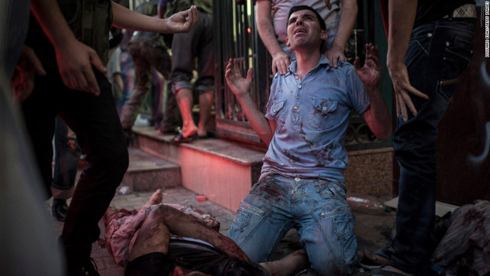 A man mourns  in front of a field hospital on August 21, 2012 in Aleppo.