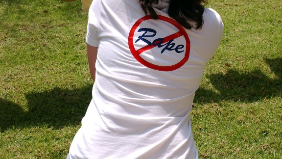 A student from John Marshall High School reads t-shirts designed by survivors of sexual abuse at the 'Denim Day in L.A. Speak-out and Rally' on April 21, 2004 at the Civic Center in Los Angeles, California. The event, part of Sexual Assault Awareness Month, encourages sexual assault victims to break their silence and speak-out about their ordeals and experiences. (Photo by Amanda Edwards/Getty Images)