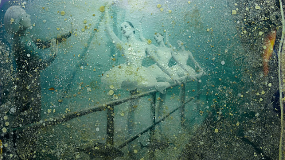 """After four months sitting at the bottom of the Gulf of Mexico, the photos became discolored with salt stains and algae. """"The sea life had created new images. It"""