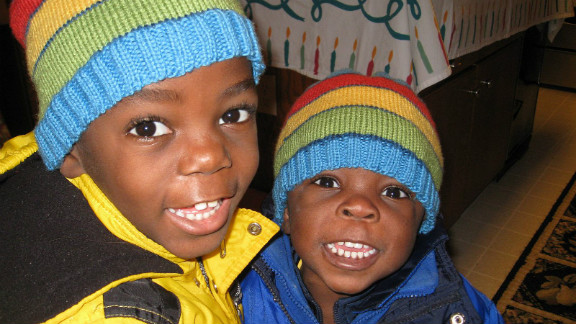 Brothers Zach, right and Philip were born in poverty in Uganda but are now living with their adopted family in the U.S.