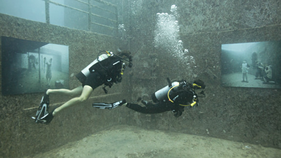 Divers check out the the photo gallery on sunken ship USNS General Hoyt S.Vandenberg, off the coast of Florida.