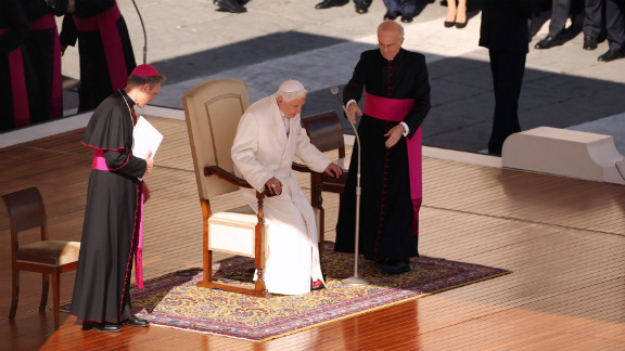 Benedict takes his seat on the dias in St. Peter
