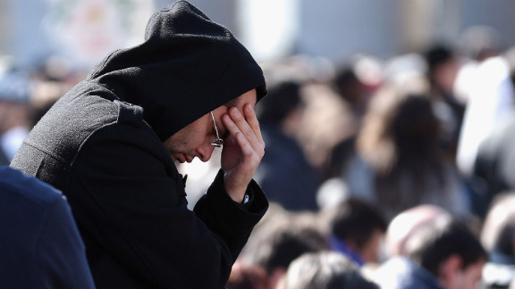 A pilgrim prays as he attends Benedict