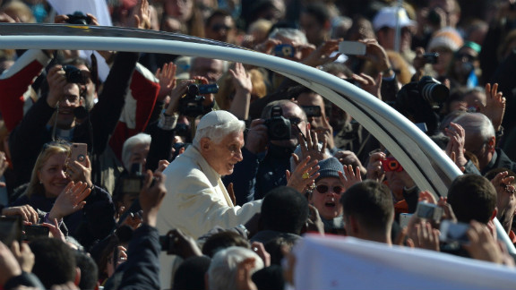 Benedict waves from to the crowd as he arrives at St. Peter