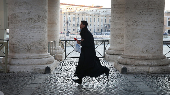 A priest runs to get into St. Peter