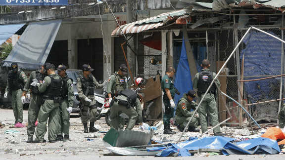 Police inspect the site of a bomb blast detonated by suspected militants in Pattani town on February 17, 2013.