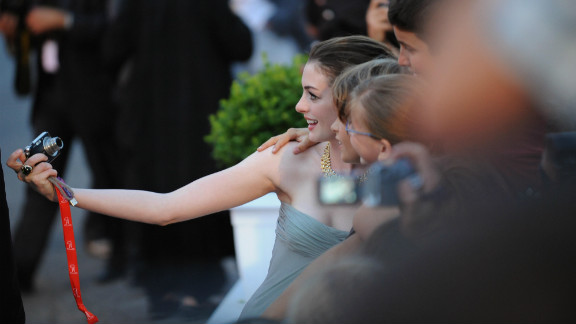 """Hathaway stops for a snapshot with fans before the screening of  """"Rachel Getting Married"""" at the Venice International Film Festival in September 2008."""
