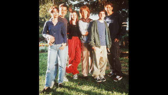"""Hathaway starred in the short-lived Fox comedy-drama """"Get Real,"""" which ran from 1999 to 2000. From left, Debrah Farentino, Jon Tenney, Hathaway, Christina Pickles, Jesse Eisenberg and Eric Christian Olsen appeared in the show."""