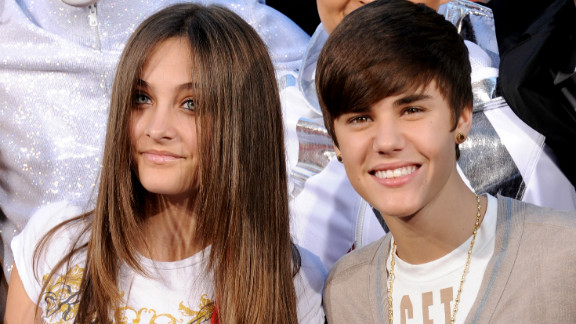 "Bieber had some of the ""most influential hair"" of 2011 and also was ranked as one of the most charitable stars. Here, he showed off his style with Paris Jackson at the Michael Jackson hand and footprint ceremony at Grauman"