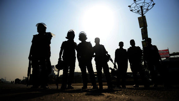 Bangladeshi police personnel stand guard during a nationwide strike in Dhaka on February 24.