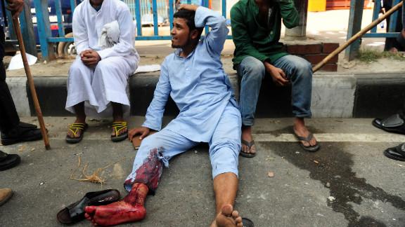 Bangladeshi police detain Islamist activists during clashes in Dhaka on February 22.